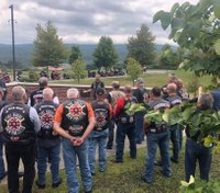 Motorcycle group of NYC firefighters visits community college's 9/11 memorial