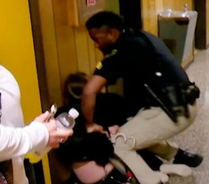 In this Monday, Jan. 8, 2018, image made from a video provided by KATC-TV middle-school English teacher Deyshia Hargrave is handcuffed by a city marshal. (KATC-TV via AP)
