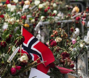 Flowers and Norwegian flags outside the court house where the killer was being tried on May 3, 2012 for the July 22, 2011 massacre. (Photo/Geir Halvorsen via Flickr)