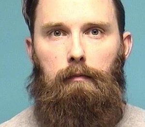 Keith Liedtke, 31, has been charged with aggravated vehicular homicide in relation to an October crash that killed his passenger and off-duty Columbia Township Firefighter-EMT Brett Wilson, 23, who was electrocuted while stopping to help. (Photo/Lorain County Jail)