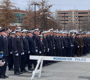 Firefighters, police officers and paramedics from across Massachusetts lined up outside Mercadante Funeral Home in Worcester on Sunday afternoon, paying their respects to Menard, who was killed in a four-alarm fire early Wednesday morning. (Photo/Worcester Fire Department)