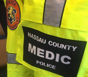 A Nassau County Police paramedic was kicked in the chest and an officer was kicked in the neck during an incident at a Walmart Saturday, officials say.