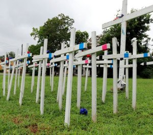An impromptu memorial filled with crosses sits in a vacant lot seven blocks south of the state Capitol building in Little Rock, Ark., on Monday, Aug. 14, 2017.