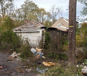 In this Oct. 19, 2014 photo is the back of a house in Gary, Ind., where the body of a woman was found on Sunday. (AP Image)