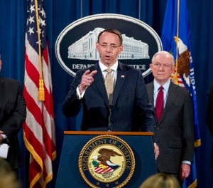 Deputy Attorney General Rod Rosenstein, center, accompanied by DEA Deputy Administrator Robert Patterson, left, Attorney General Jeff Sessions, second from right, and FBI Acting Director Andrew McCabe, right, speaks at a news conference to announce an international cybercrime enforcement action at the Department of Justice, Thursday, July 20, 2017, in Washington. (AP Photo/Andrew Harnik)
