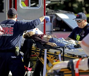First responders tend to a victim after a mass shooting at Marjory Stoneman Douglas High School. (Photo/AP)