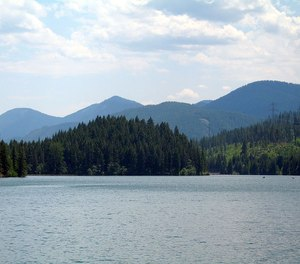 The firefighter was paddle boarding on Cle Elum Lake with a friend on Saturday.