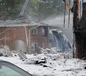 Firefighting foam covers the scene of a crash. (Photo/U.S. Navy)
