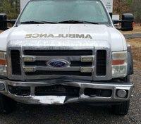 Va. man charged after head-on collision with ambulance