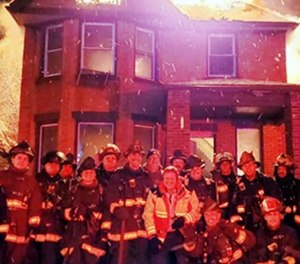 Higginbotham filed a negligence lawsuit against the city of Detroit, the Detroit Fire Department and all the firefighters in the photo. (Photo/Detroit Fire Incidents Page)