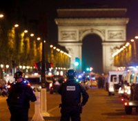 Officials: Police had Paris attacker in their grasp