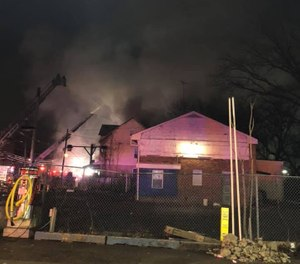 Two FDNY firefighters were arrested in New Jersey for repeatedly crossing police lines and ignoring police commands at a three-alarm blaze in Trenton. The firefighters were charged with failure to disperse and each paid a fine. (Photo/Signal 22 Canteen Unit Facebook)