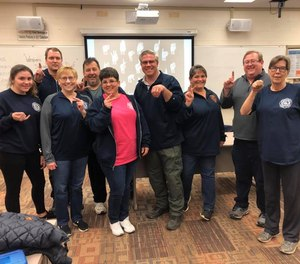 First responders with the Sharpsburg Volunteer Fire Department were among the dozens who participated in an American Sign Language class in Allegheny County this week.