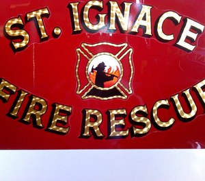 An off-duty St. Ignace firefighter suffered smoke inhalation after rescuing a neighbor from a fire on Thanksgiving.