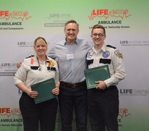 Kevin DeVries (center) met Life EMS providers Christy Carter (left) and Colin Chrenka at an award ceremony on Wednesday. Carter and Chrenka revived DeVries after he went into cardiac arrest last summer. (Photo/Life EMS Ambulance Facebook)