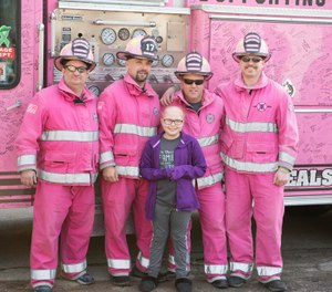 Emilee Derrer, 10, received a surprise visit by dozens of first responders, some dressed in pink gear, to show their support after she was diagnosed with leukemia. Emilee's father is a Mt. Carroll Fire Department captain and her mother is an EMT in Savanna. (Photo/Mount Carroll Fire Department Facebook)