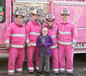 Emilee Derrer, 10, received a surprise visit by dozens of first responders, some dressed in pink gear, to show their support after she was diagnosed with leukemia. Emilee's father is a Mt. Carroll Fire Department captain and her mother is an EMT in Savanna.