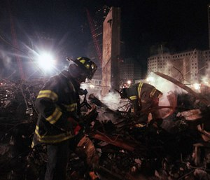 Firefighters from Staten Island's Rescue 5 company search for victims in the