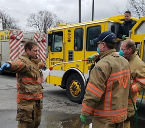 City firefighters in Watertown, N.Y. participate in DECON procedure training. Firefighter Peyton L.S. Morse died during a training exercise earlier this spring.