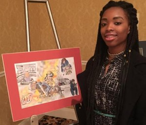 Jasmine Williams, from Edna Karr High School, with her winning poster. (Photo/of Jeneen Graves Williams)
