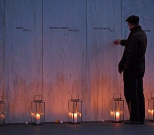 A man pays his respects at the Wall of Names at the United Flight 93 National Memorial in Shanksville, Pa., Saturday, Sept. 10, 2017.