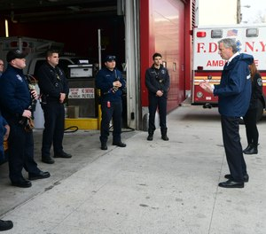 New York City Mayor Bill de Blasio speaks with EMTs and paramedics at FDNY EMS Station 50 in Queens on Thursday, April 2. De Blasio said in a radio interview Friday that the COVID-19 pandemic is