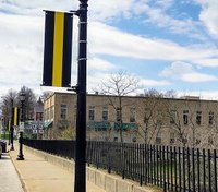 Banners displayed on Ohio bridge pay tribute to emergency dispatchers