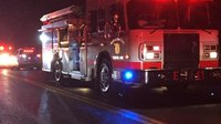 2 rescued after Conn. fire chief notices garage blaze