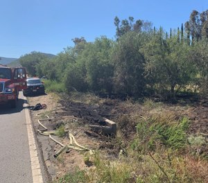 A man suffered an apparent heart attack while running to get help for a brush fire on the side of a California highway. (Photo/CAL FIRE/San Diego County Fire Facebook)