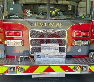 High Point firefighters say an anonymous donor left eight boxes containing 160 N95 respirator masks with their fire engine while they were out shopping for groceries. (Photo/High Point Fire Department Facebook)