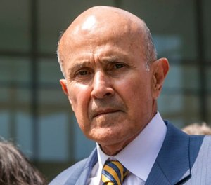In this May 12, 2017, file photo, former Los Angeles County Sheriff Lee Baca leaves federal court in Los Angeles after he was sentenced to three years in prison for obstructing an FBI investigation into abuses at the jails he ran. (AP Photo/Damian Dovarganes, File)