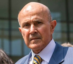 Former Los Angeles County Sheriff Lee Baca leaves federal court in Los Angeles after he was sentenced to three years in prison for obstructing an FBI investigation into abuses at the jails he ran. (AP Photo/Damian Dovarganes)
