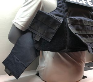"New body armor products on display included the Hardcore FE from Armor Express, which comes with or without MOLLE panels and has what the company calls a ""dynamic armored cummerbund."" (Photo/Ron LaPedis)"