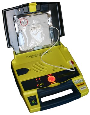 AEDs are a crucial component of out of hospital cardiac arrest survival. Finding funding matters. (Photo/Wikimedia Commons)