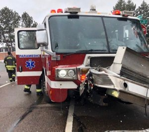 Four Colorado firefighters were injured when their fire apparatus collided with another vehicle.