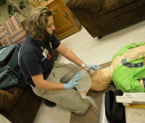 A student practices bag-valve mask ventilation