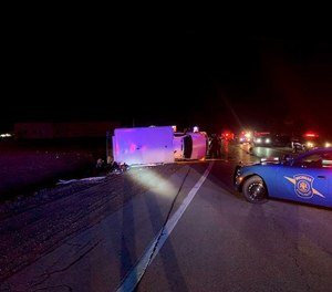 Four people were injured, including two ambulance crewmembers and their patient, in a rollover ambulance collision on Monday.