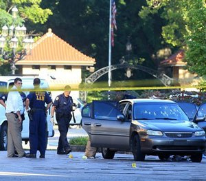 St. Louis police investigate the scene of a shooting where a gunman opened fire on a uniformed St. Louis police sergeant on Tuesday, July 14, 2015.