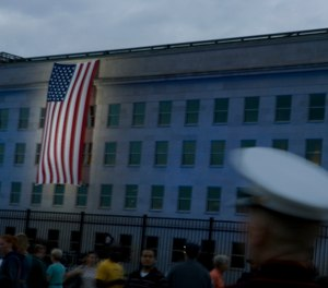 A flag hangs from the Pentagon near the September 11 Pentagon Memorial. The author's son was serving at the Pentagon during the 2001 attacks.