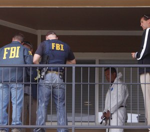 Federal agents get ready to search the apartment of a terrorism suspect in Aurora, Colorado.