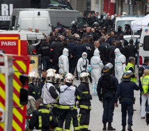 Police, fire and EMS chiefs, along with hospital doctors, are asked to exercise crisis leadership by connecting, collaborating and coordinating with each other to cope with the various aspects of active shooter incidents. (AP Photo/Peter Dejong)