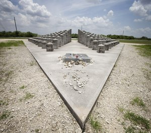 In this 2014 photo, rocks, coins and other items are left at the ValuJet Memorial in Everglades National Park, honoring the 110 people killed in the ValuJet Flight 592 crash on May 11, 1996. Tuesday marks the 25th anniversary of the tragedy.