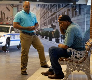 A New York City police officer talks to an actor during a Crisis Intervention Training class at the New York Police Department Police Academy in New York.