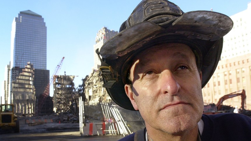 Lee Ielpi pauses near Ground Zero in New York, where he later found the remains of his son, Jonathan.
