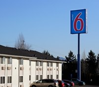 Police: Naked woman kicked EMT in the face at motel