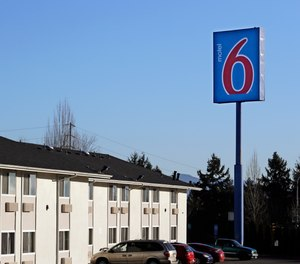 Police say a naked woman who may have ingested an unknown substance kicked an EMT in the face at a Motel 6.
