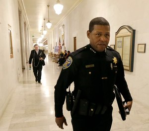 This Tuesday, Dec. 12, 2017 file photo San Francisco Police Chief William Scott walks to a meeting at City Hall in San Francisco.