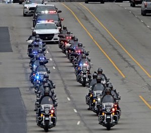 """A long line of IMPD, Sheriff, and State Police officers escort the body of Boone Co. sheriff's deputy Jacob """"Jake"""" Pickett, Monday, Mar. 5, 2018. (Kelly Wilkinson/The Indianapolis Star via AP)"""
