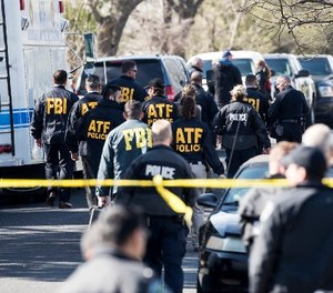 Authorities work on the scene of an explosion in Austin on Monday, March 12, 2018. (Ricardo B. Brazziell/Austin American-Statesman via AP)