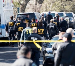 Authorities work on the scene of an explosion in Austin on Monday, March 12, 2018.